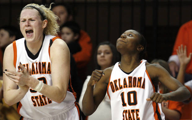OKLAHOMA STATE UNIVERSITY / WOMEN'S COLLEGE BASKETBALL: OSU's Megan Byford (33) and Andrea Riley (10) celebrate OSU's win over Centenary, Tuesday, Jan. 6, 2009, at Gallagher-Iba Arena in Stillwater, Okla. PHOTO BY SARAH PHIPPS, THE OKLAHOMAN ORG XMIT: KOD