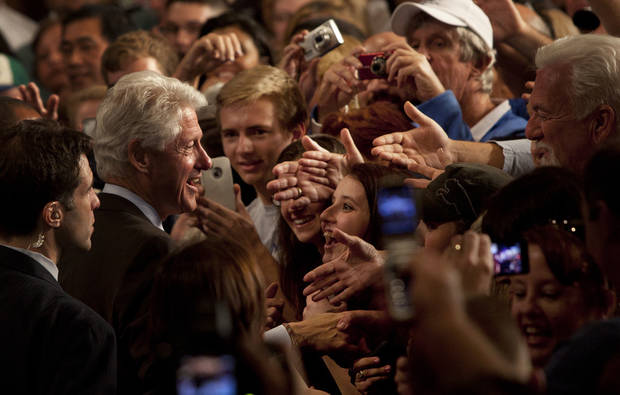 Former U.S. President Bill Clinton greets supporters at the Harborside Convention Center Friday, Nov. 2, 2012 in Fort Myers, Fla. (AP Photo/The News-Press, Andrew West) MAGS OUT; NAPLES OUT; NO SALES