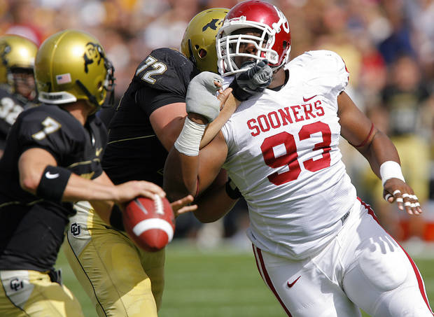 Oklahoma's Gerald McCoy (93) gets past the block of Colorado's Devin Head (72) to put pressure on quarterback Cody Hawkins (7) during the first half of the college football game between the University of Oklahoma Sooners (OU) and the University of Colorado Buffaloes (CU) at Folsom Field on Saturday, Sept. 28, 2007, in Boulder, Co. 