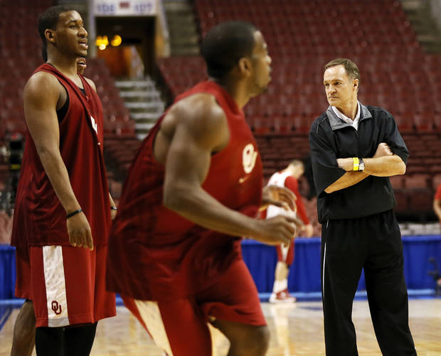 Oklahoma coach Lon Kruger looks to the sideline as Sam Grooms (1), middle, in front of Steven Pledger (2) during the practice and press conference day for the second round of the NCAA men's college basketball tournament at the Wells Fargo Center in Philadelphia, Thursday, March 21, 2013. OU will play San Diego State in the second round on Friday. Photo by Nate Billings, The Oklahoman