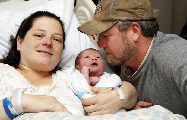 Robin Martin and Ben Martin pose for a photo with their newborn son, Easton Martin, at Integris Baptist Medical Center  in Oklahoma City, Wednesday, Dec. 12, 2012. Easton Martin was born by C-section at 12:12 and 12 seconds on 12/12/12. Photo by Nate Billings, The Oklahoman