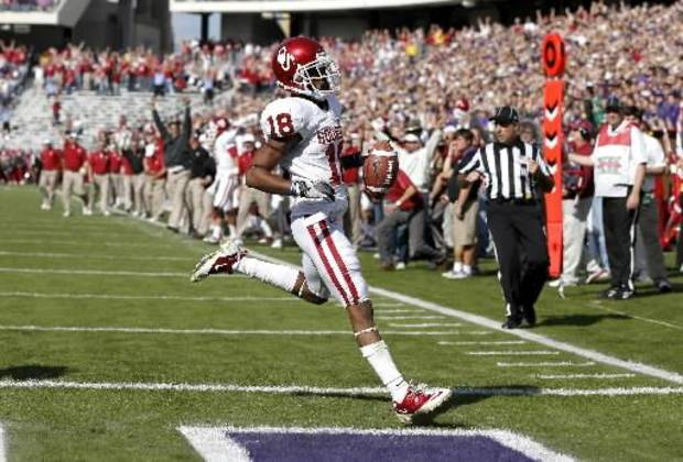 Oklahoma wide receiver Jalen Saunders scores a touchdown against TCU.