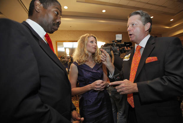 Republican labor Commissioner Mark Costello, right talks with Cindy Lankford and Harold Roberts at the republican Watch Party at the Marriott on Tuesday, Nov. 2, 2010, in Oklahoma City, Okla.   Photo by Chris Landsberger, The Oklahoman