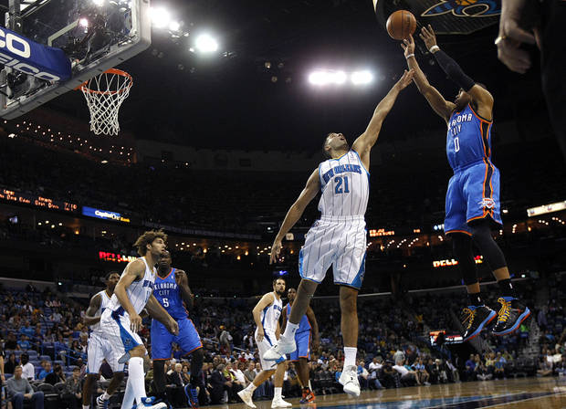 Oklahoma City Thunder guard Russell Westbrook (0) shoots over New Orleans Hornets guard Greivis Vasquez (21) in the first half of an NBA basketball game in New Orleans, Saturday, Dec. 1, 2012. (AP Photo/Gerald Herbert) ORG XMIT: LAGH104