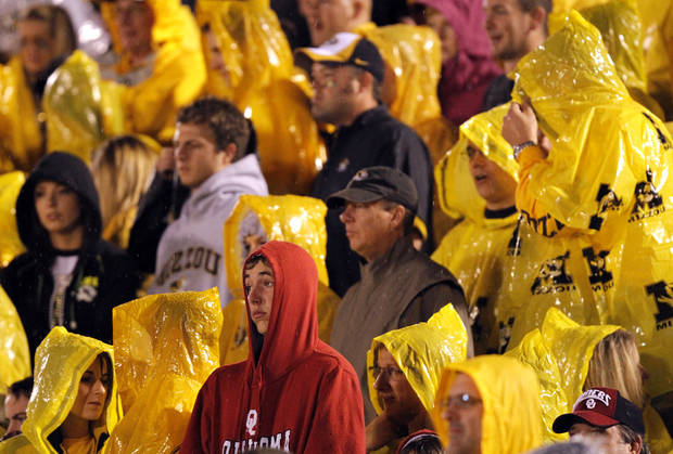 An Oklahoma fan is surrounded by Missouri Tiger fans while watching the game from the stands during the second half of the college football game between the University of Oklahoma Sooners (OU) and the University of Missouri Tigers (MU) on Saturday, Oct. 23, 2010, in Columbia, Mo. Oklahoma lost the game 36-27. Photo by Chris Landsberger, The Oklahoman