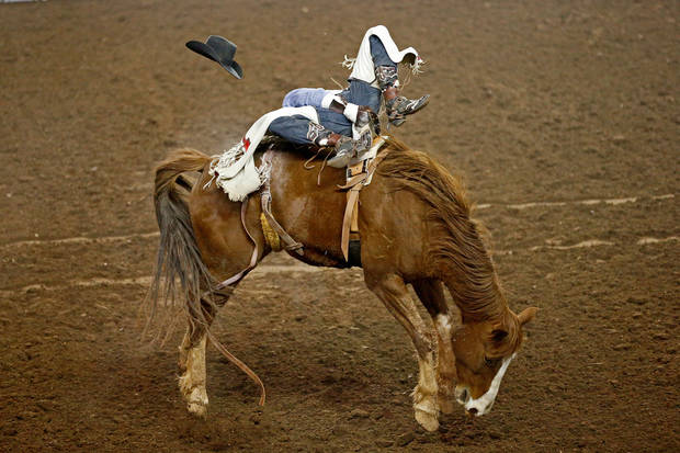 Caleb Bennett holds on during the bareback competition in National Circuit Finals Rodeo at the State Fair Arena, Saturday, April 6, 2013. Photo by Bryan Terry, The Oklahoman