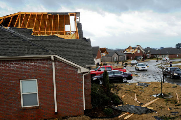 Several homes on Royal St. George Lane in the Canebrake neighborhood in Athens, Ala.  have their roofs damaged or blown off on Friday, March 2, 2012.  A reported tornado destroyed several houses in northern Alabama as storms threatened more twisters across the region Friday.  (AP Photo/The Decatur Daily,  Gary Cosby Jr)   ORG XMIT: ALDEC105