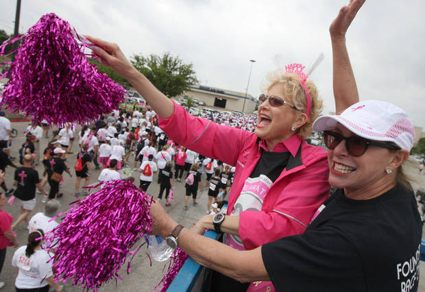 In this April 14, 2012, photo local race founders Joan Katz and Rozanne Rosenthal cheer on runners at the start of the Susan G. Komen Race for the Cure in Fort Worth, Texas. Nine of the years 135 races have been held so far, with eight reporting a drop in participation numbers ranging from around 10 percent to 30 percent, Fort Worth reporting about a 23 percent drop. While race organizers cite the economy and other possible contributing factors, there is also an acknowledgment of the effect of the Planned Parenthood debacle, which angered both people on both sides of the abortion debate. (AP Photo/Star-Telegram, Joyce Marshall) MAGS OUT