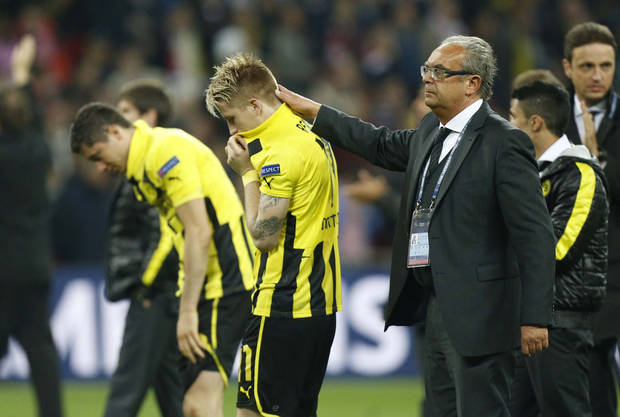 Players of  Borussia Dortmund react after being defeated by Bayern Munich in the Champions League Final soccer match at Wembley Stadium in London, Saturday May 25, 2013. (AP Photo/Jon Super)
