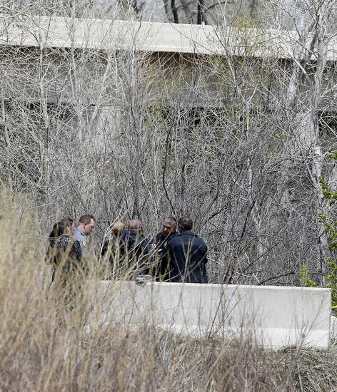 Oklahoma City Police investigate a body found in the Stinchcomb Wildlife Refuge just north of the end of Morgan Rd. near the Kilpatrick Turnpike in Oklahoma City, Saturday, April 20, 2013. Photo by Nate Billings, The Oklahoman