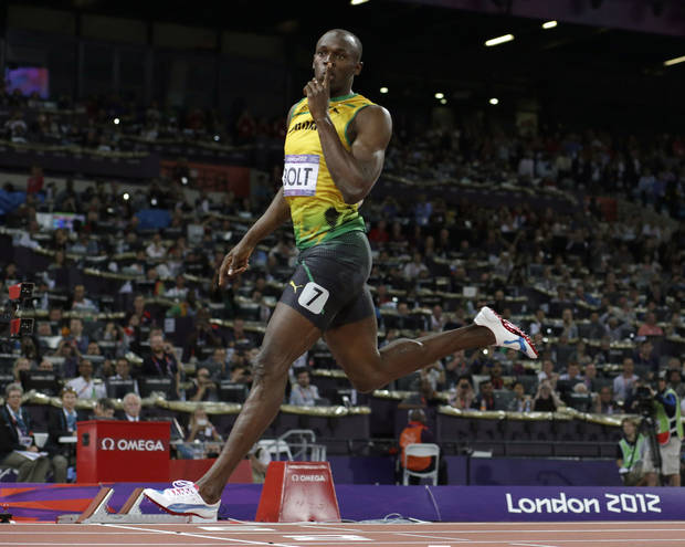 FILE - In this Thursday, Aug. 9, 2012 file photo, Jamaica's Usain Bolt gestures as he crosses the finish line to win gold in the men's 200-meter final during the athletics in the Olympic Stadium at the 2012 Summer Olympics, in London. (AP Photo/David J. Phillip, File)
