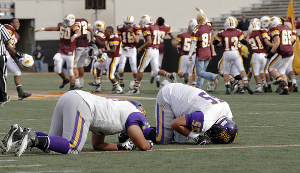 Anadarko&#039;s Dakota Botone (77) and James Paddlety (55) react after the 21-14 loss to Clinton during the Class 4A Oklahoma state championship football game between Anadarko and Clinton at Boone Pickens Stadium on Saturday, Dec. 1, 2012, in Stillwater, Okla.   Photo by Chris Landsberger, The Oklahoman