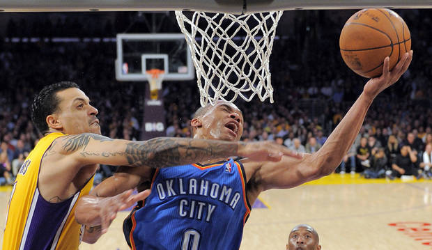 Oklahoma City Thunder guard Russell Westbrook, right, puts up a shot as Los Angeles Lakers forward Matt Barnes defends during the first half of an NBA basketball game, Thursday, March 29, 2012, in Los Angeles. (AP Photo/Mark J. Terrill)  ORG XMIT: LAS102