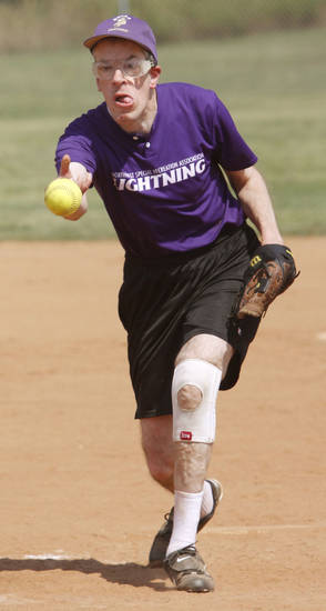 Illinois Lightning�s John Lordots delivers a pitch during the 2012 Special Olympics North America Softball Invitational Tournament at Bickham Softball Park in  Edmond.