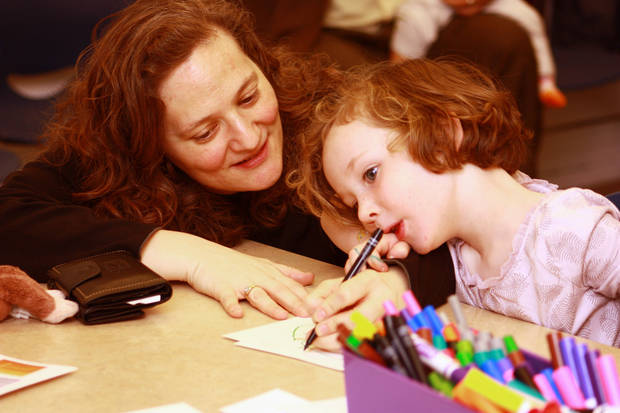 Jennifer Shaiman helps daughter Dorothy Cusack, 4, with a drawing Sunday during Family Day at the Fred Jones Jr. Museum of Art. PHOTOS BY LYNETTE LOBBAN, FOR THE OKLAHOMAN