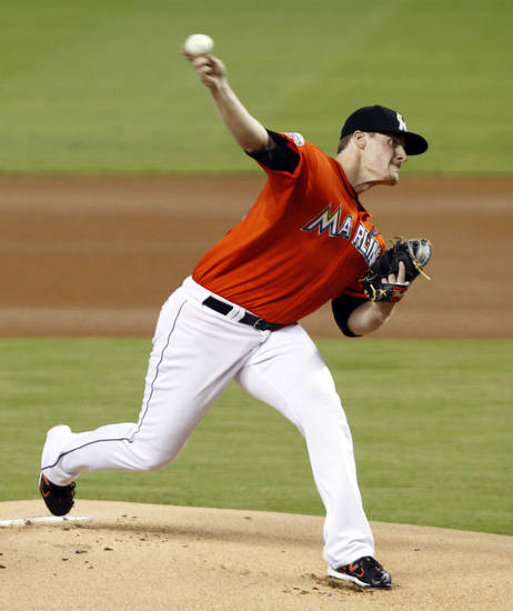 Miami Marlins' Tom Koehler pitches to the New York Mets during the first inning of a baseball game in Miami, Wednesday, Oct. 3, 2012. (AP Photo/Alan Diaz)
