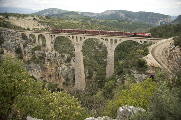 "Some of the action in the new James Bond movie ""Skyfall"" takes place featuring this train on the Varda Bridge in Turkey. PHOTO PROVIDED BY MGM/COLUMBIA PICTURES. <strong>Jasin Boland</strong>"