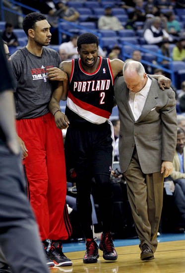 Portland Trail Blazers guard Wesley Matthews (2) is helped off the court after being injured in the first half of an NBA basketball game against the New Orleans Hornets in New Orleans, Wednesday, Feb. 13, 2013. (AP Photo/Gerald Herbert)