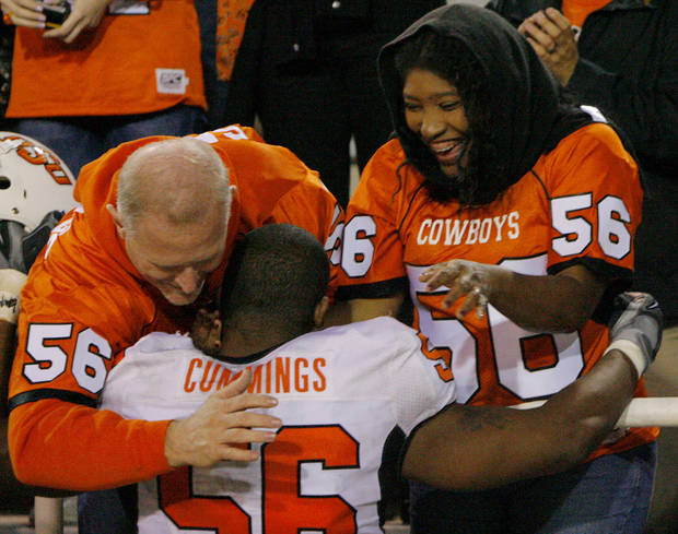 Maurice Cummings (56) hugs his mother Margaret and step-father Charles Salter following the college football game between Oklahoma State University and Baylor University at Floyd Casey Stadium in Waco, Texas, Saturday, Nov. 17, 2007. BY MATT STRASEN, THE OKLAHOMAN