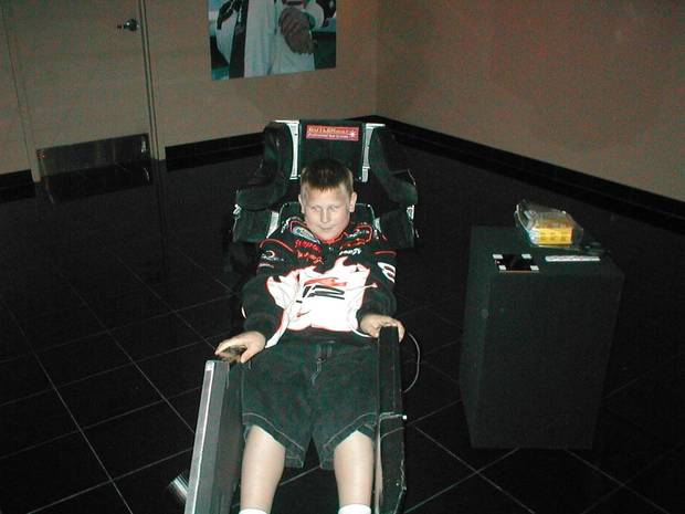 My middle son Kelvin sitting in an actual Nascar racing seat from Mark Green's car.  Photo taken in Mooresville, NC at Dale Earnhardt Inc. April 2004.<br/><b>Community Photo By:</b> Michelle Brister<br/><b>Submitted By:</b> Michelle, Pauls Valley
