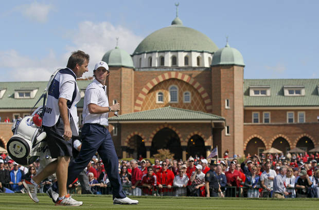 Europe's Rory McIlroy walks off the first tee during a singles match at the Ryder Cup PGA golf tournament Sunday, Sept. 30, 2012, at the Medinah Country Club in Medinah, Ill. (AP Photo/Charles Rex Arbogast)  ORG XMIT: PGA111