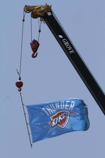 OKLAHOMA CITY THUNDER / MIAMI HEAT / NBA FINALS / NBA BASKETBALL / SUPPORT / INTERSTATE 44: Wild art. Thunder Up. A Thunder flag hangs from a crane at Lippert Brothers Inc., 2211 I-44 Service Road, Monday, June 18, 2012. Photo By David McDaniel/The Oklahoman