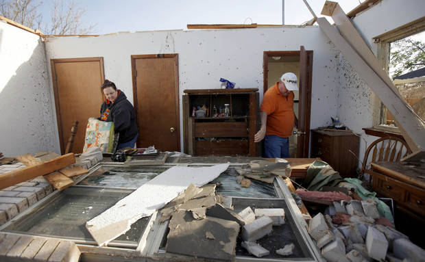Pam, left, and Terry Nelson sort through items inside the home of Terry&#039;s mother after a tornado damaged the home in Woodward, Okla., Sunday, April 15, 2012. Photo by Bryan Terry