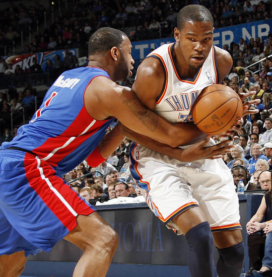Detroit's Tracy McGrady (1) knocks the ball away from Kevin Durant (35) of Oklahoma City during an NBA basketball game between the Oklahoma  City Thunder and the Detroit Pistons at the OKC Arena in Oklahoma City, Friday, March 11, 2011. Photo by Nate Billings, The Oklahoman