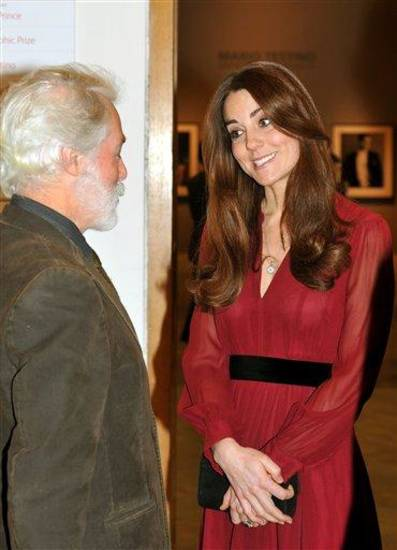 The Duchess of Cambridge meets artist Paul Emsley after viewing her newly-commissioned portrait at the National Portrait Gallery in central London, Friday Jan. 11, 2013. (AP Photo/John Stillwell, Pool)