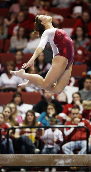 OU's Sara Stone competes on the beam during the Beauty and the Beast event at the Lloyd Noble Center in Norman, Okla., where the University of Oklahoma wrestling team competed against Virginia Tech and the OU women's gymnastics team competed against North Carolina State, Friday, Jan. 27, 2012. Photo by Nate Billings, The Oklahoman