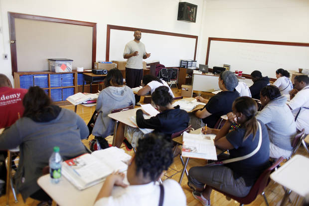 Londaryl Perry teaches his history class at Northeast Academy. PHOTO BY DOUG HOKE, THE OKLAHOMAN
