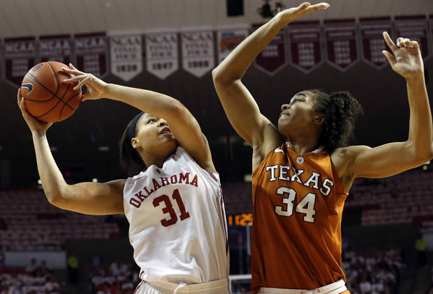 Oklahoma Sooners' Portia Durrett (31) shoots guarded by Texas Longhorn's Imani McGee-Stafford (34) as the University of Oklahoma Sooners (OU) play the University of Texas (UT) Longhorns in NCAA, women's college basketball at The Lloyd Noble Center on Saturday, Jan. 19, 2013 in Norman, Okla. Photo by Steve Sisney, The Oklahoman