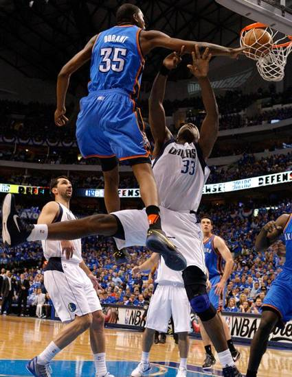 Oklahoma City's Kevin Durant (35) goes past Brendan Haywood (33) of Dallas during game 2 of the Western Conference Finals in the NBA basketball playoffs between the Dallas Mavericks and the Oklahoma City Thunder at American Airlines Center in Dallas, Thursday, May 19, 2011. Photo by Bryan Terry, The Oklahoman