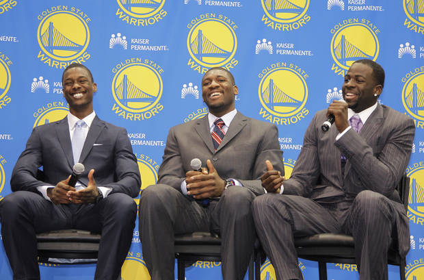 New Golden State Warriors draft picks Harrison Barnes, left, a forward from North Carolina, Festus Ezeli, center, a center from Vanderbilt, and Draymond Green, right, a forward from Michigan State, laugh during a news conference at Warriors headquarters in Oakland, Calif., Monday, July 2, 2012. (AP Photo/Paul Sakuma)