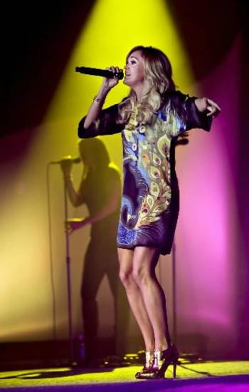 In this photo provided by Toys R Us, Inc., recording artist Carrie Underwood performs at the 2011 Toys R Us Children's Fund Gala on Thursday, May 19, 2011, in New York.