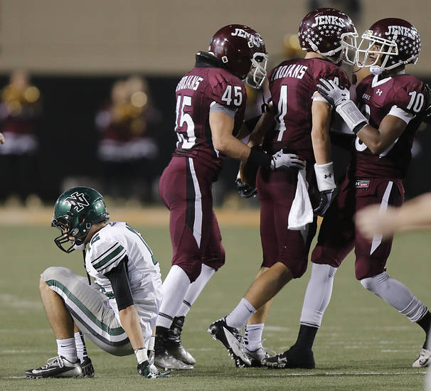 Jenks' Danny Hoyt (45), Dylan Harding (4) and Steven Parker (10) celebrate a stop as Norman North's Jake Higginbotham (12) gets off the ground during the Class 6A Oklahoma state championship football game between Norman North High School and Jenks High School at Boone Pickens Stadium on Friday, Nov. 30, 2012, in Stillwater, Okla.   Photo by Chris Landsberger, The Oklahoman