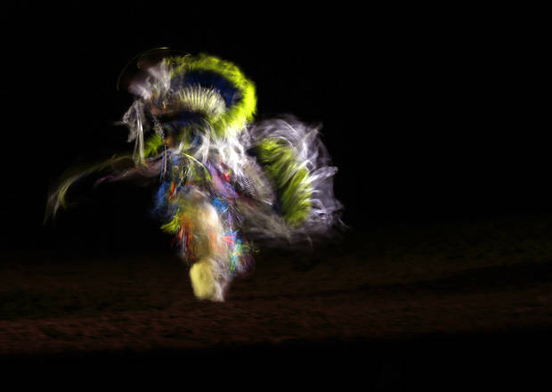 A Native American dancer performs before the National Circuit Finals Rodeo at the State Fair Arena in Oklahoma City, Thursday, April 4, 2013. Photo by Bryan Terry, The Oklahoman