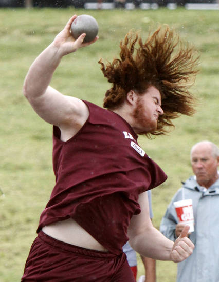 Edmond Memorial's Jordan Weltzheimer competes in the shot put during the 5A and 6A state finals track meet at Yukon High School in Yukon, OK, Friday, May 11, 2012,  By Paul Hellstern, The Oklahoman