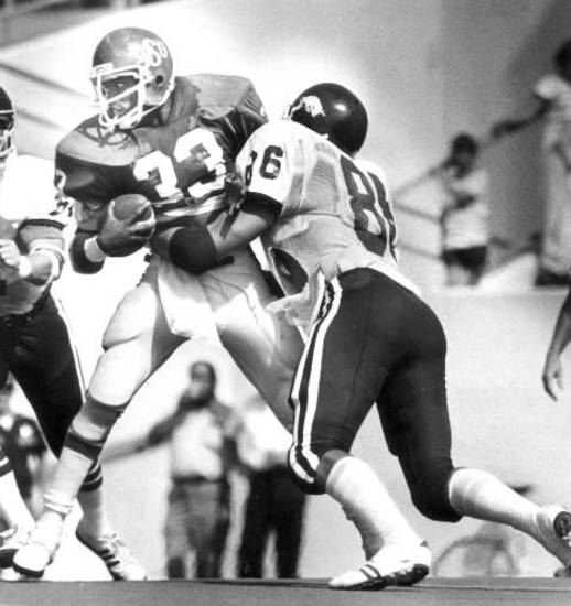 9/23/1978- Oklahoma State running back Worley Taylor tries to get away from Arkansas' Dan Hampton. Staff photo by Doug Hoke.