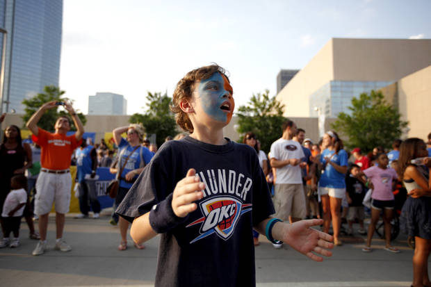 Lawson Lewis, 7, of Oklahoma City cheers in Thunder Alley before the Game 2 of the first round in the NBA playoffs between the Oklahoma City Thunder and the Dallas Mavericks at Chesapeake Energy Arena in Oklahoma City, Monday, April 30, 2012. Photo by Sarah Phipps, The Oklahoman