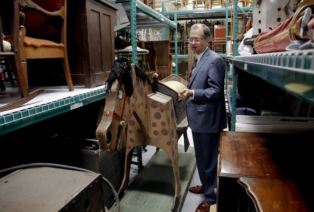 "Bob Blackburn, executive director of the Oklahoma History Center, speaks Monday about 'Woody the Birthday Horse"" in the storage facility at the Oklahoma History Museum in Oklahoma City. Photo by Chris Landsberger, The Oklahoman <strong>CHRIS LANDSBERGER</strong>"