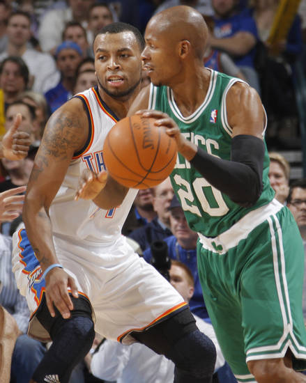 Oklahoma City Thunder shooting guard Daequan Cook (14) defends on Boston Celtics shooting guard Ray Allen (20) during the NBA basketball game between the Oklahoma City Thunder and the Boston Celtics at the Chesapeake Energy Arena on Wednesday, Feb. 22, 2012 in Oklahoma City, Okla.  Photo by Chris Landsberger, The Oklahoman
