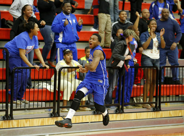 Millwood's Chris Cook celebrates Millwood's win in a Class 3A boys state basketball tournament game between Hugo and Millwood at Yukon High School in Yukon, Okla., Thursday, March 7, 2013. Photo by Bryan Terry, The Oklahoman