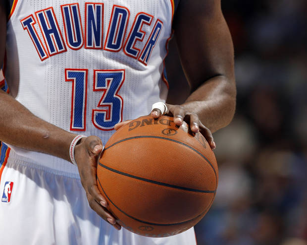 Oklahoma City's James Harden (13) is pictured with tape around his finger during the NBA basketball game between the Oklahoma City Thunder and the Portland Trail Blazers at Chesapeake Energy Arena in Oklahoma City, Sunday, March 18, 2012. Photo by Sarah Phipps, The Oklahoman.