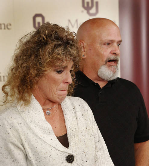 At a Monday news conference at the Samis Education Center, Tammy Cauthron and husband, David Cauthron, discuss the surgical process of reconstructing the face of their son, Taron Pounds.