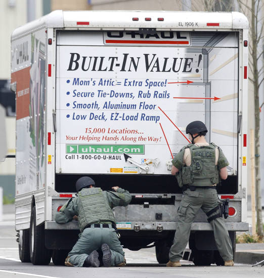 BOMB SCARE: Members of the Oklahoma City Police Bomb Squad search a U-Haul truck parked on Walker Avenue in downtown Oklahoma City , Wednesday April 17, 2013. Photo By Steve Gooch, The Oklahoman ORG XMIT: OKC1303121532440650