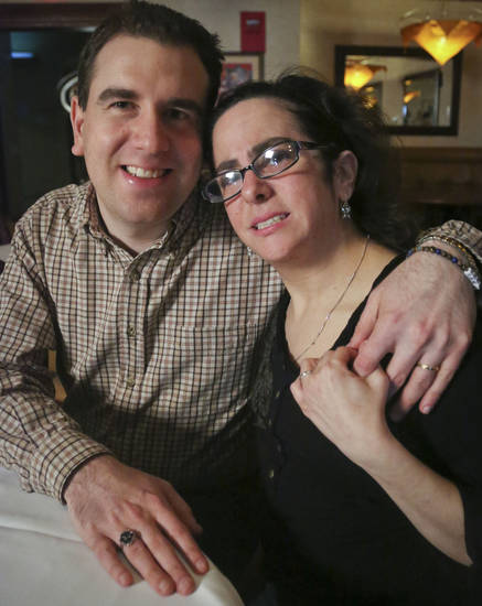 Paul Farziano and Hava Samuels pose during an interview on Thursday, April 25, 2013 in Port Jefferson, N.Y.  The developmentally disabled couple brought a lawsuit against the group facilities where they live for violating the Disability Act, by refusing them residence as a married couple.  (AP Photo/Bebeto Matthews)