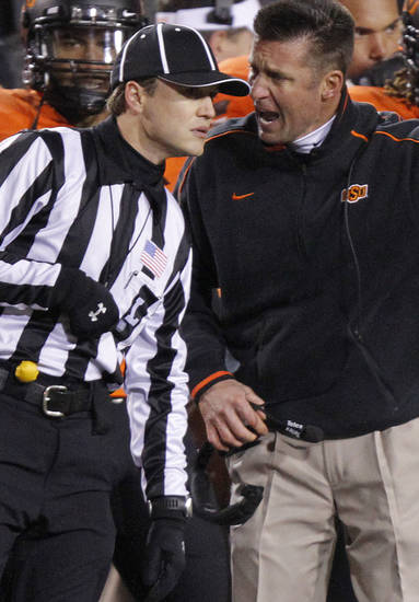 Oklahoma State coach Mike Gundy yells at the official during the Bedlam college football game between the Oklahoma State University Cowboys (OSU) and the University of Oklahoma Sooners (OU) at Boone Pickens Stadium in Stillwater, Okla., Saturday, Dec. 3, 2011. Photo by Chris Landsberger, The Oklahoman