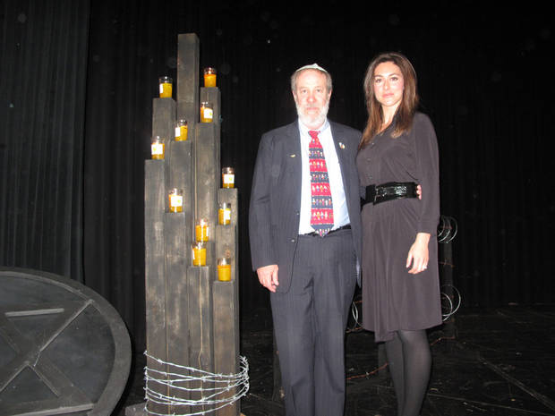 Michael Korenblit and Erielle Roodman Reshef stand beside candles lit in memory of Holocaust  survivors during the 2013 Holocaust Remembrance Program Sunday at Bethany High School. The program is sponsored each year by the Jewish Federation of Greater Oklahoma City. <strong>Photo by Carla Hinton</strong>