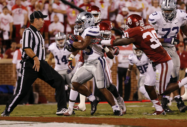 Kansas State's John Hubert (33) scores a touchdown past Oklahoma's Javon Harris (30) during the college football game between the University of Oklahoma Sooners (OU) and the Kansas State University Wildcats (KSU) at the Gaylord Family-Memorial Stadium on Saturday, Sept. 22, 2012, in Norman, Okla. Photo by Chris Landsberger, The Oklahoman